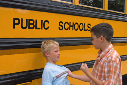 Bullying- school boys at bus